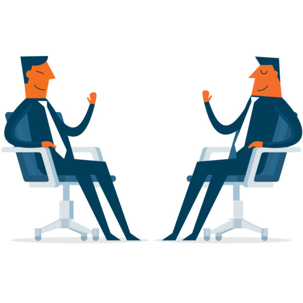 Image of two people sitting down in chairs having a meeting.