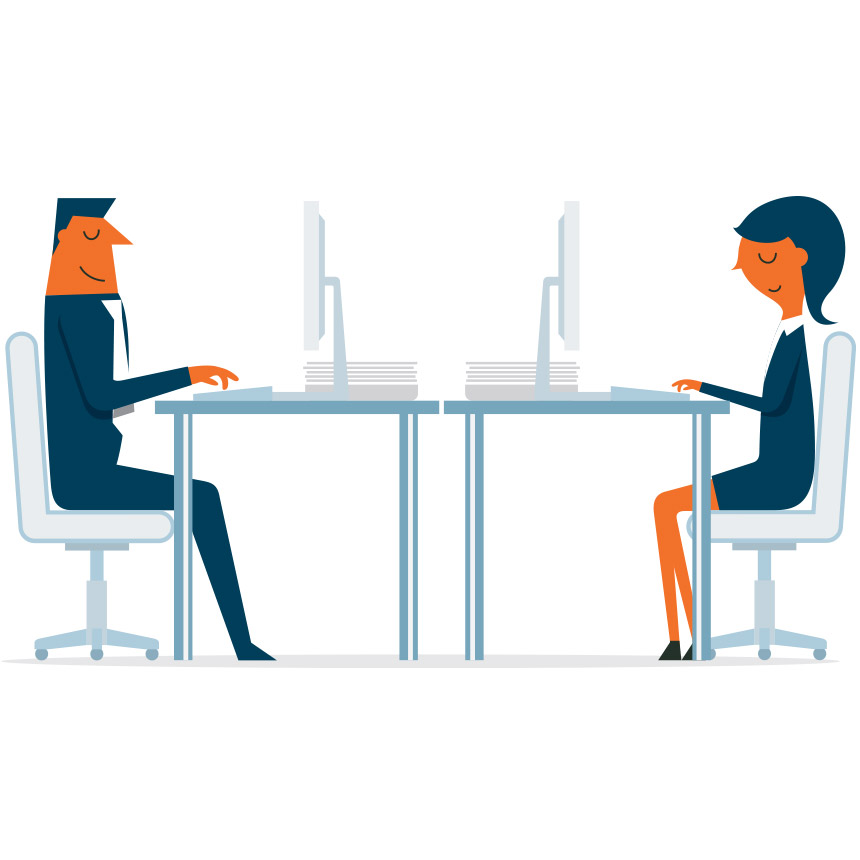 Image of two people working at their desks