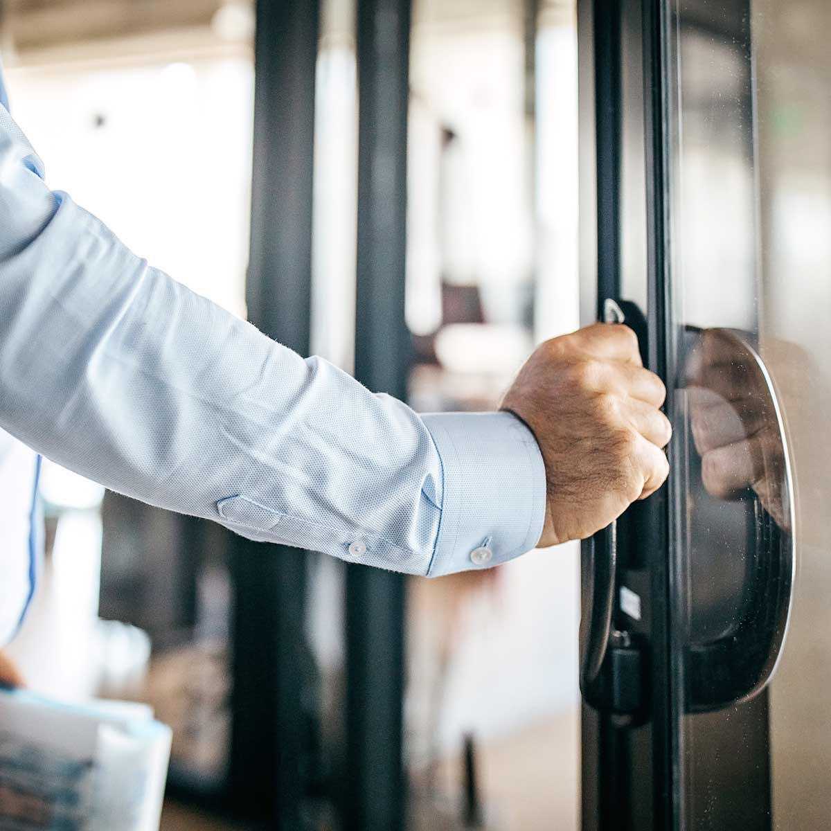 Image of someone closing a door