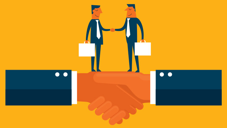 Men making first impressions by shaking hands