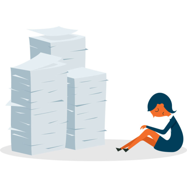 Image of someone sitting by a big pile of papers.