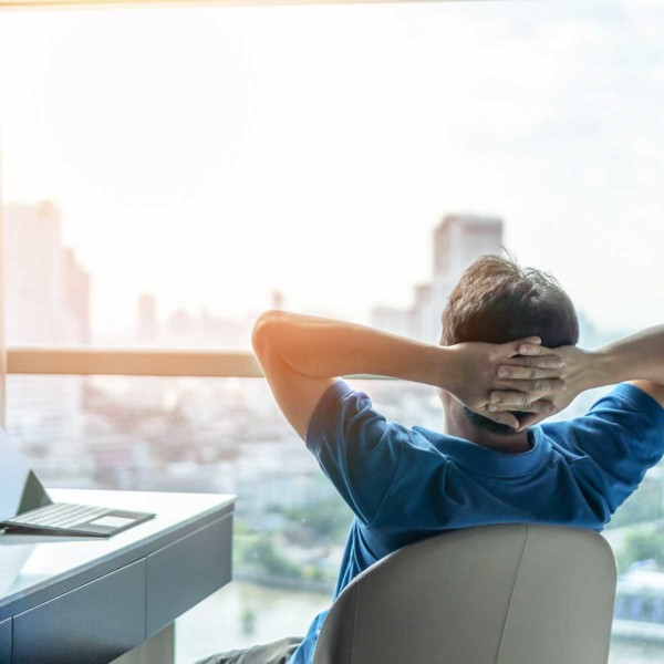Image of someone taking a break while looking out a window.