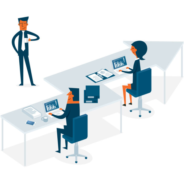 Image of two people working at a desk that is shaped like an arrow.