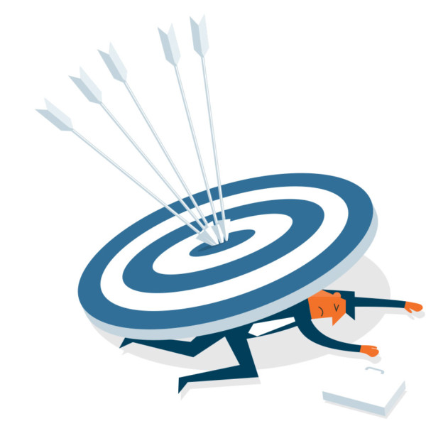 Image of someone underneath a large target with arrows in it.