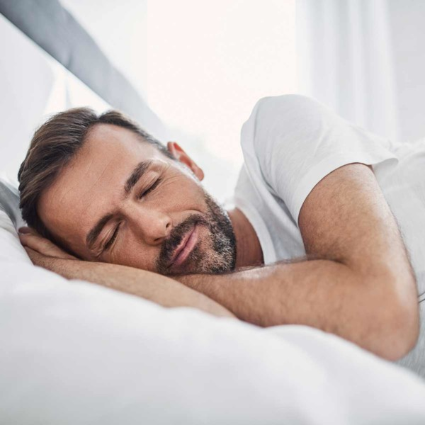 Image of someone asleep in bed.