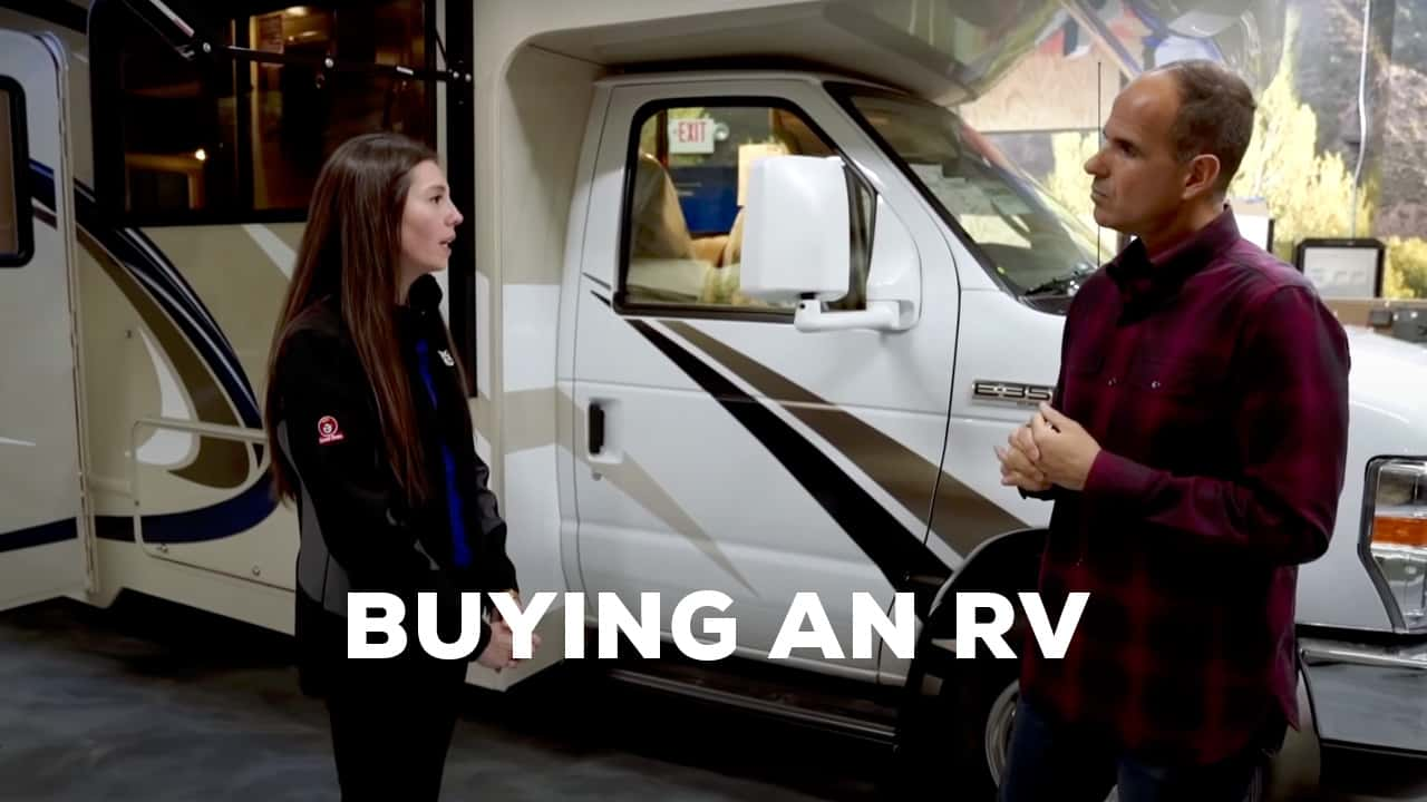 Image of Marcus Lemonis negotiating with someone looking to buy an RV.