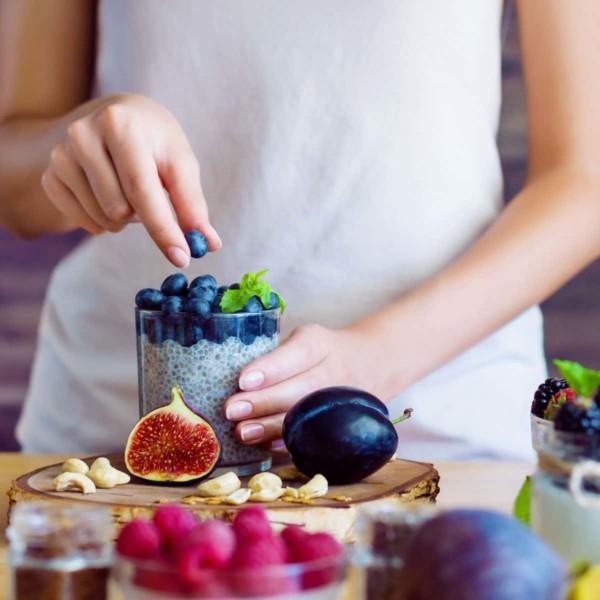 women making a chia smoothie with blueberries