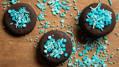 Chocolate cookies covered in blue sprinkles