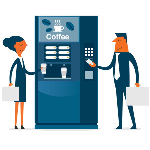 Image of two people standing by a coffee machine.
