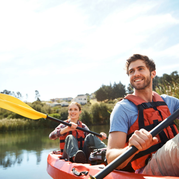 couple kayaking outdoors in a lake