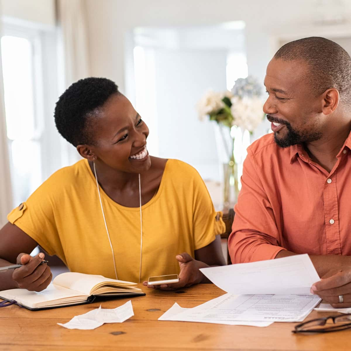 Couple looking through papers to check their spending