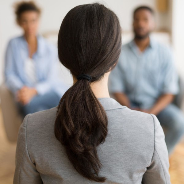 couple meeting with an adoption professional