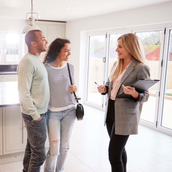 Couple speaking with a realtor about buying their new home