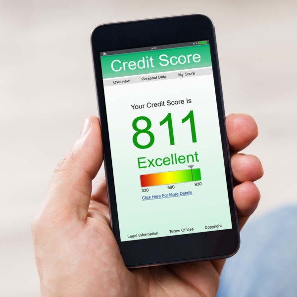 Image of phone with a credit score app on screen.