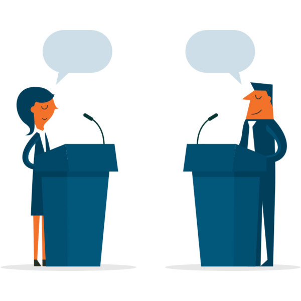 Image of two people standing at podiums having a debate.