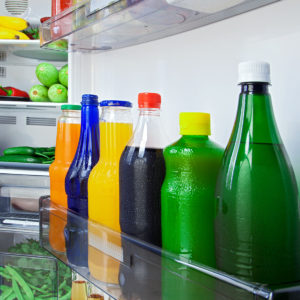 Different types of juices chilling in the fridge