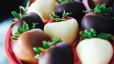Close-up of eight chocolate covered strawberries