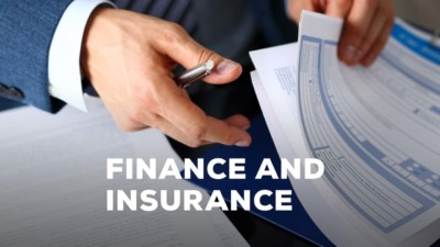 Image of someone flipping through pages in a folder, with the words 'Finance and Insurance' over top the image.