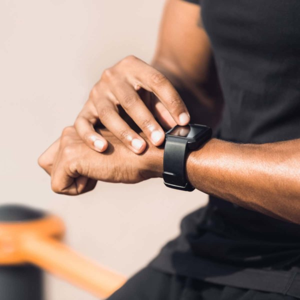 Image of someone using a fitness tracker watch.