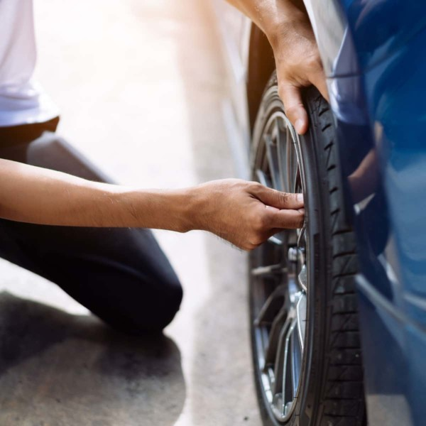 person fixing their tire