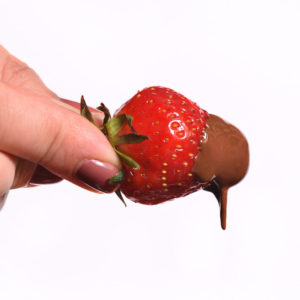 Strawberry that was freshly dipped in melted chocolate