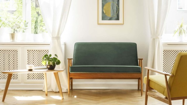 Green couch in vintage style home