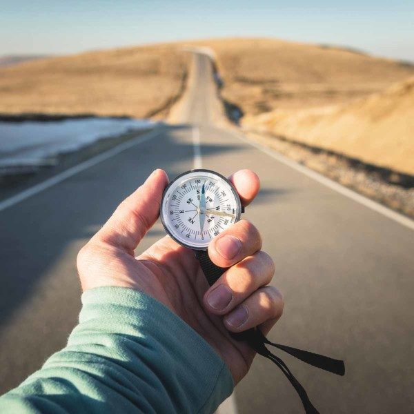 Image of someone holding a compass