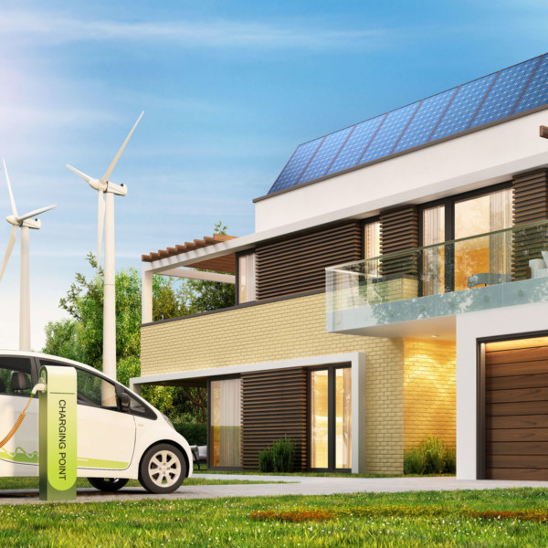 Image of the outside of a home with windmills and an electric car.