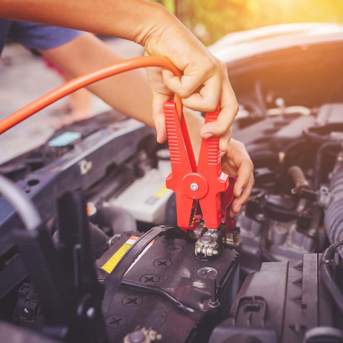 hooking up jumper cable to a car