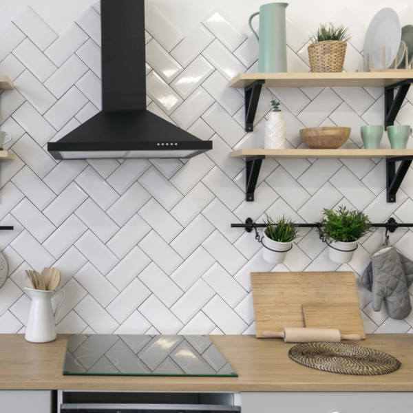 kitchen with floating shelves with green decor accents