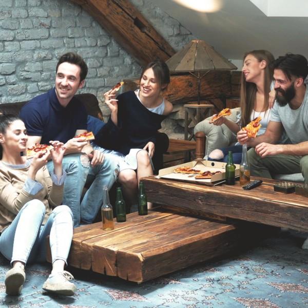 friends on a sofa having fun