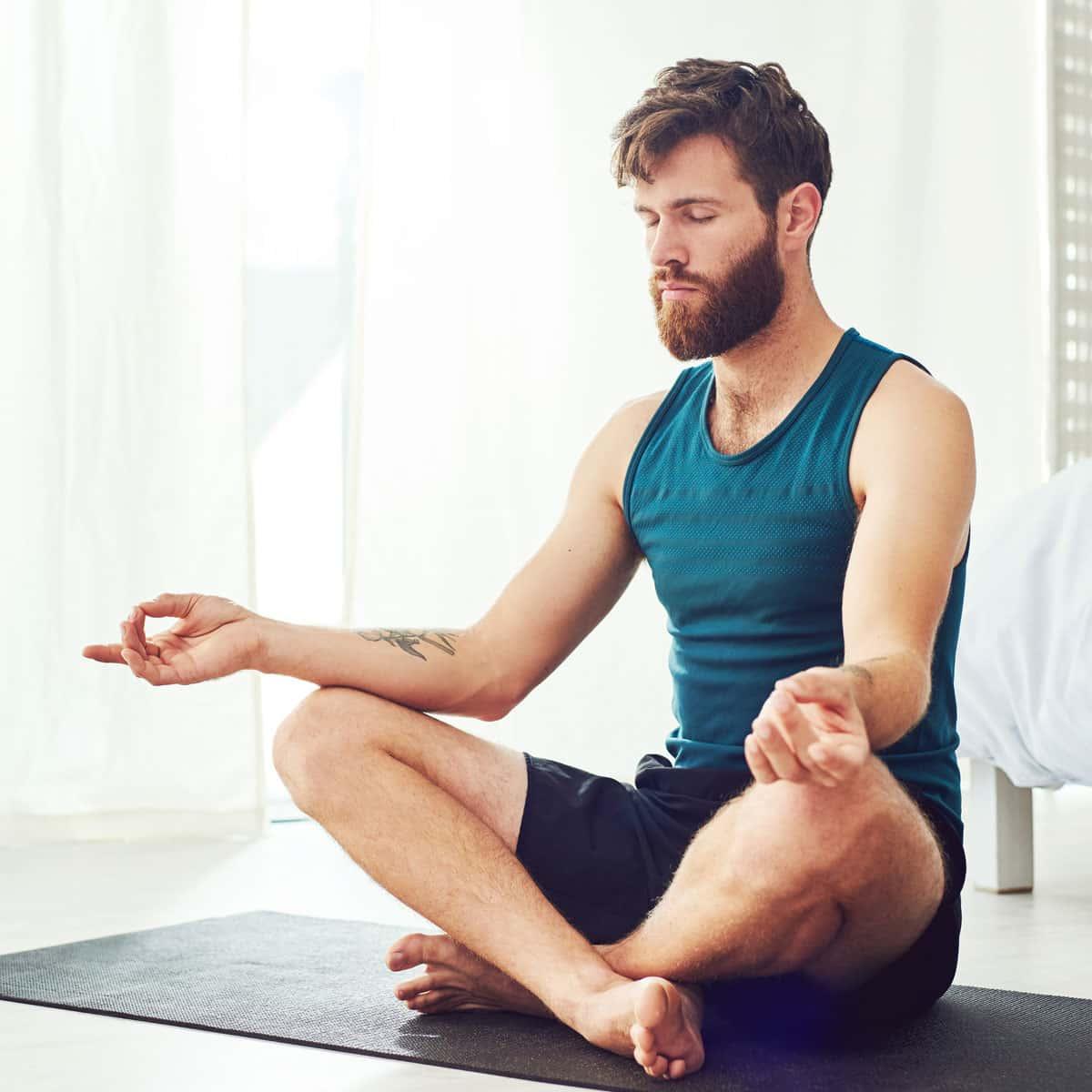 man meditating on a yoga mat