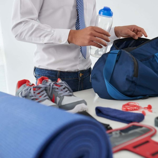 Man packing his gym bag so he can workout on the go