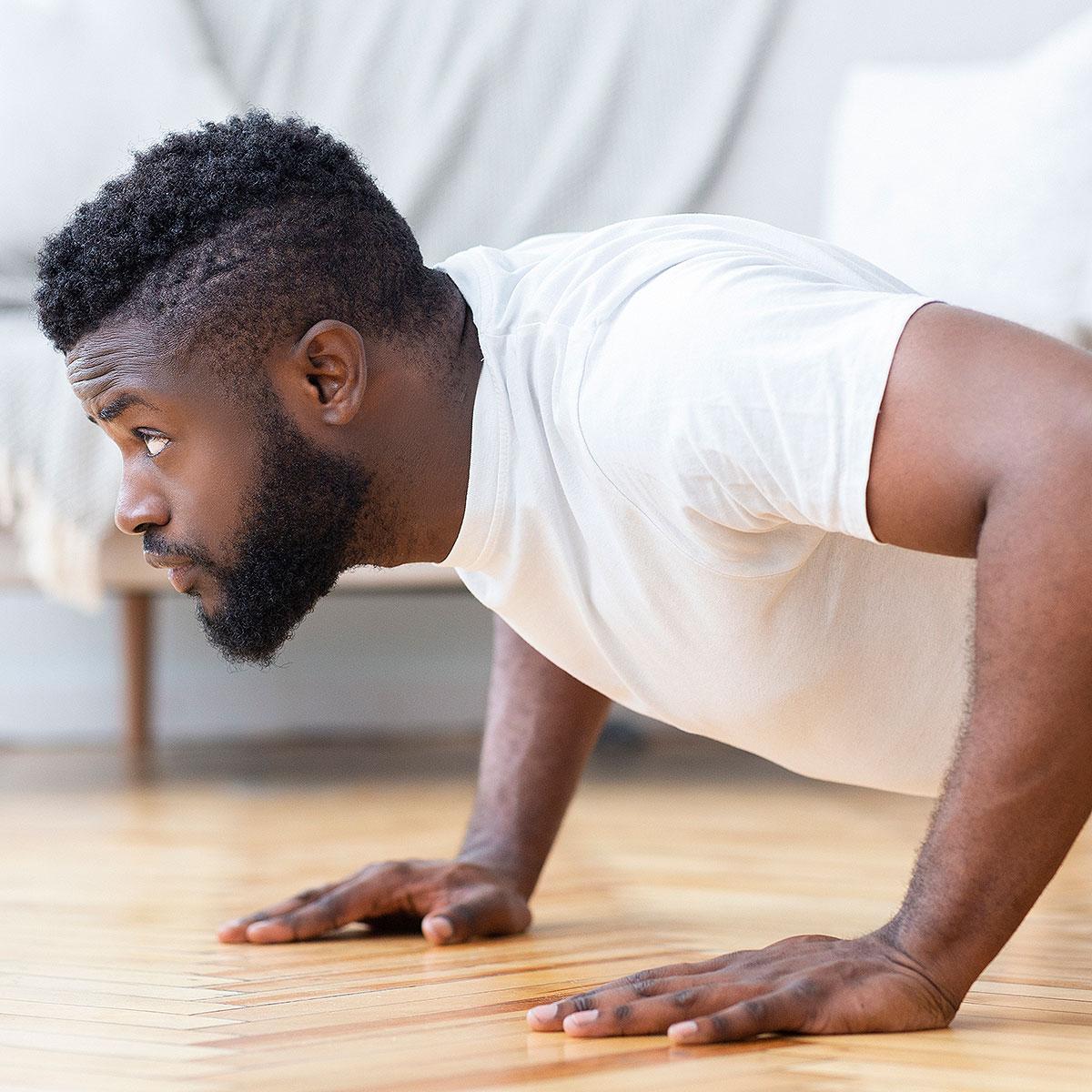man doing push ups at home