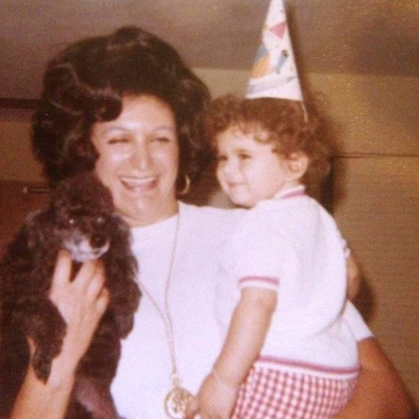 Image of Marcus Lemonis as a child with his mother.