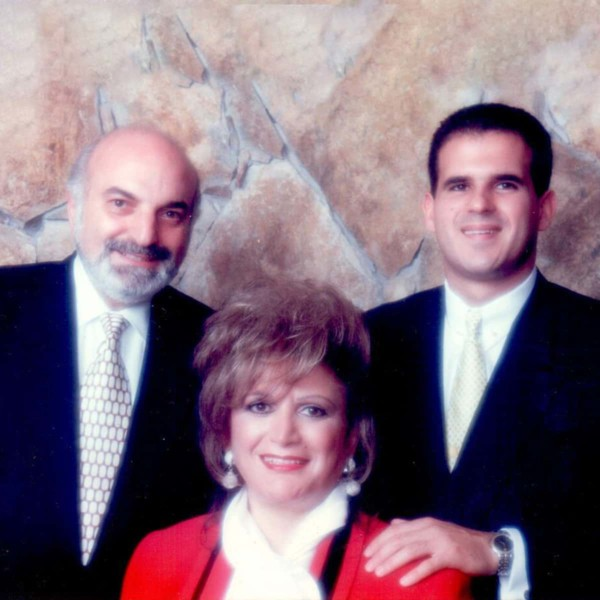 Image of a younger Marcus Lemonis with his parents.