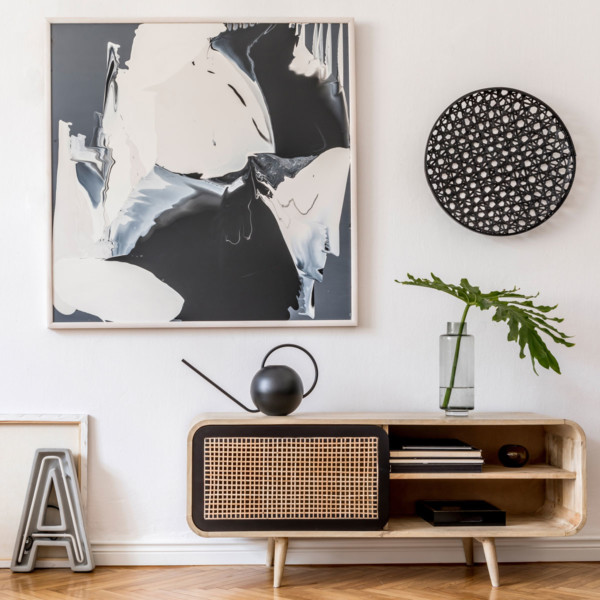 tv console and modern wall decor and a really cool round teapot
