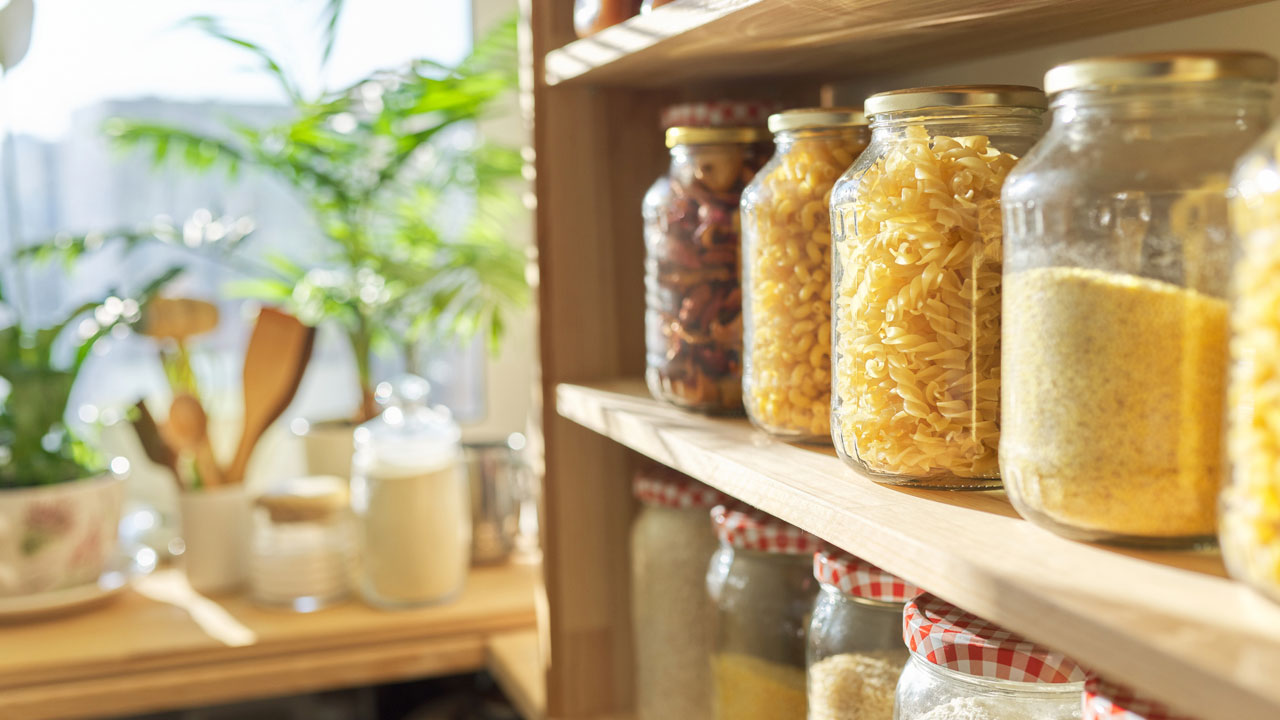 Image of a pantry with various jars.