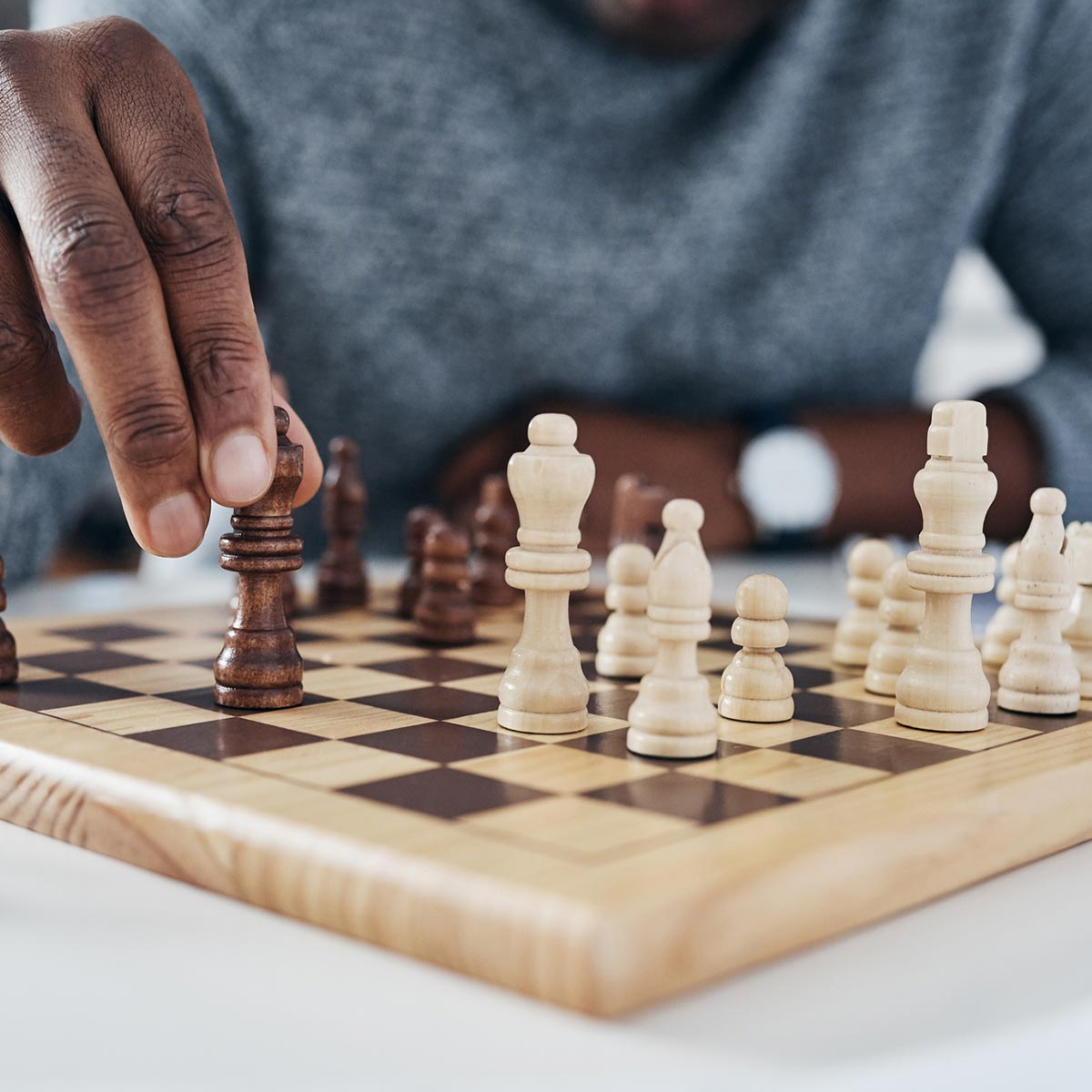 Image of someone playing chess.
