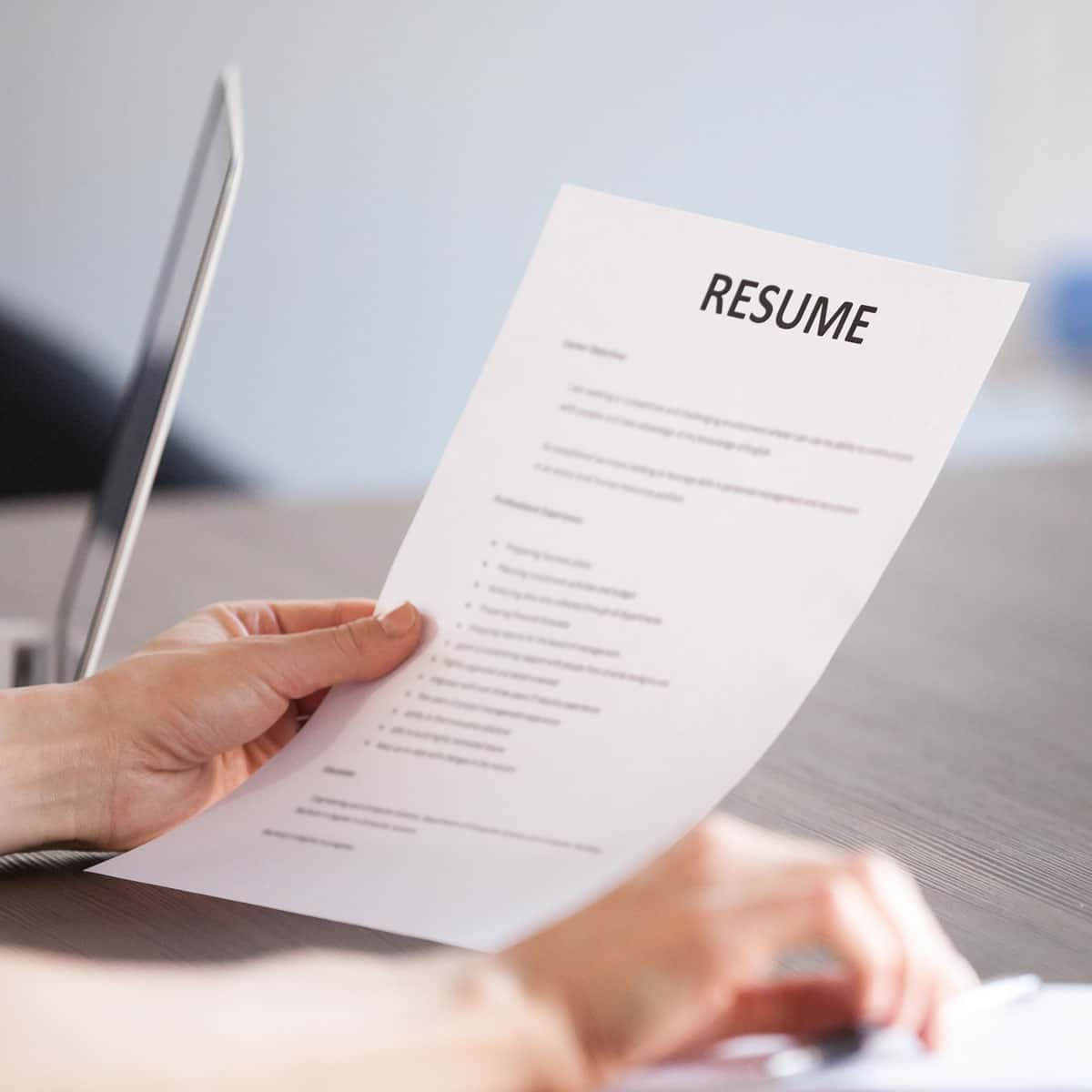 person looking at their resume