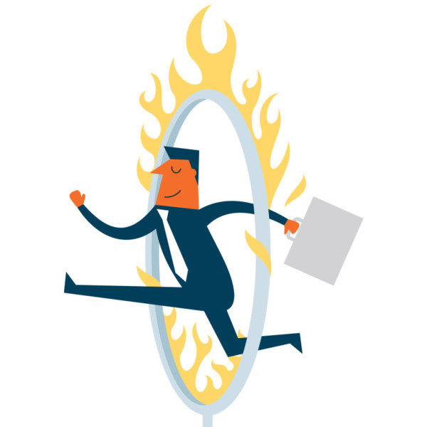 Image of someone jumping through a ring of fire.