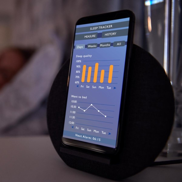 Image of a phone with a sleep tracker app on screen.