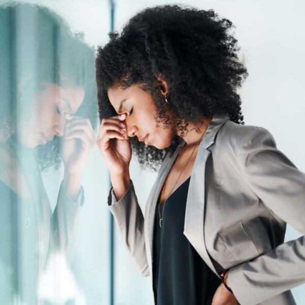 women stressed by a window
