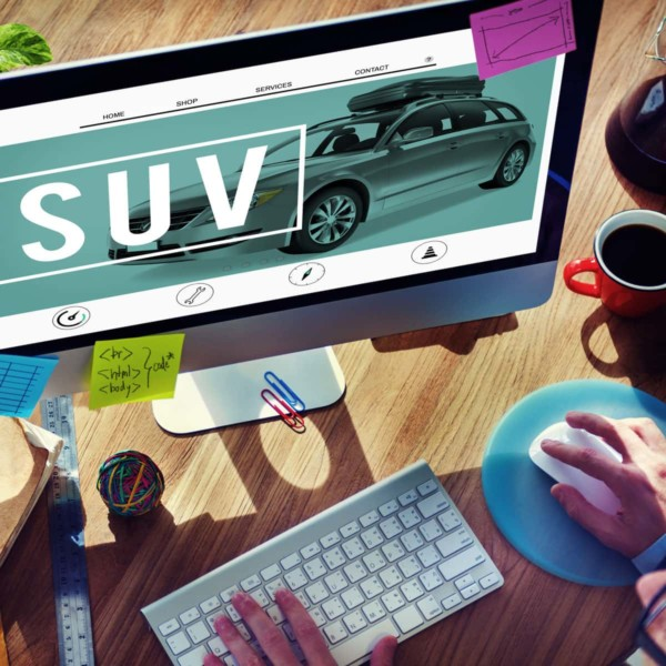 Image of someone looking at a website for an SUV.