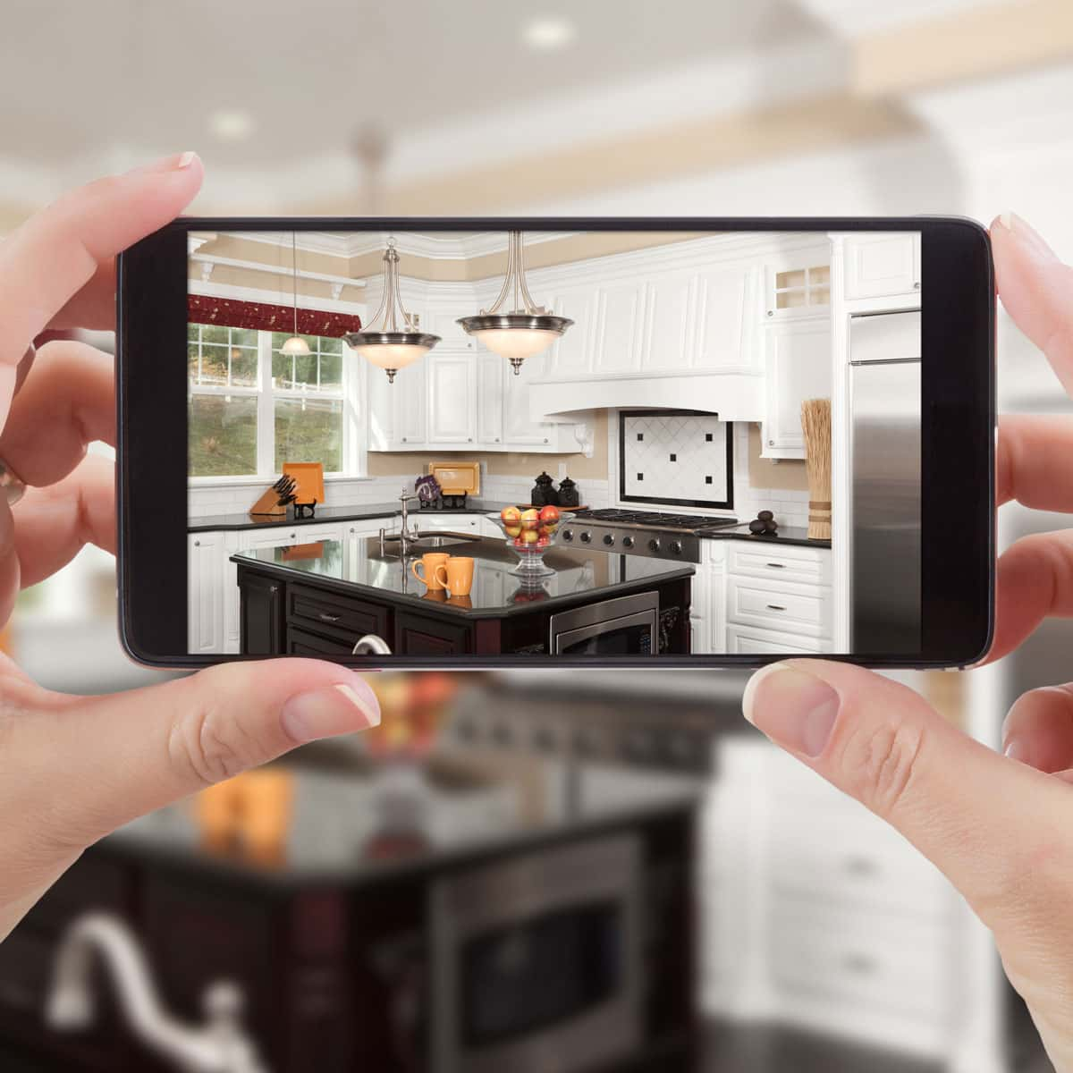 Taking a photo of the new kitchen on a phone