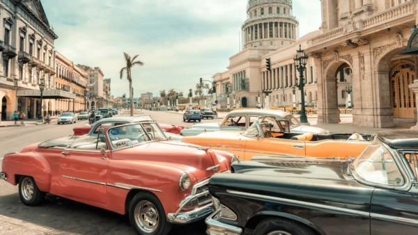 Image of cars on a road in Cuba.