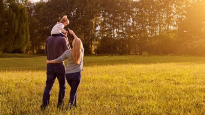 Image of a family walking through a field.