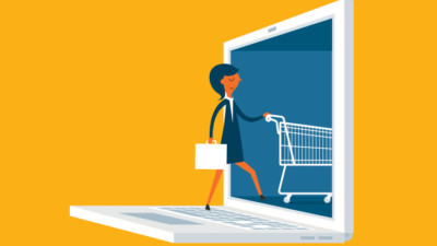 Image of someone walking into a laptop with a shopping cart and briefcase.