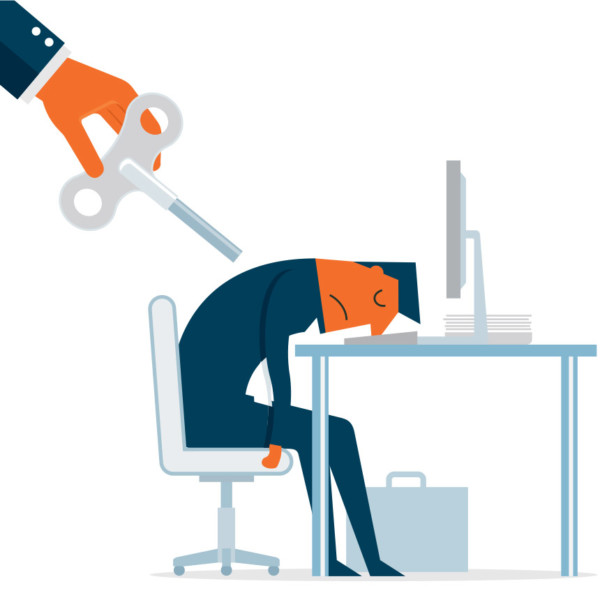 Image of someone going to wind up a worker asleep at a desktop.