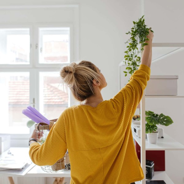 Woman decorating house with plants
